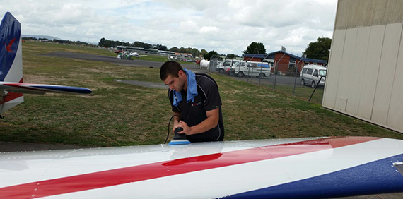 Jaco Pienaar buffing the wing of a cessna